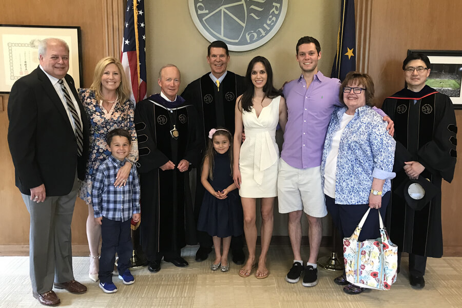 Krach and family with Purdue University President, Mitch Daniels and Dean Mung Chiang, before graduation ceremonies to receive honorary doctorate in engineering