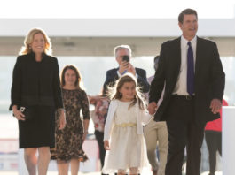 Left to right: Metta Krach, Jacqueline and Marc Carlson (background), Emma and Keith Krach